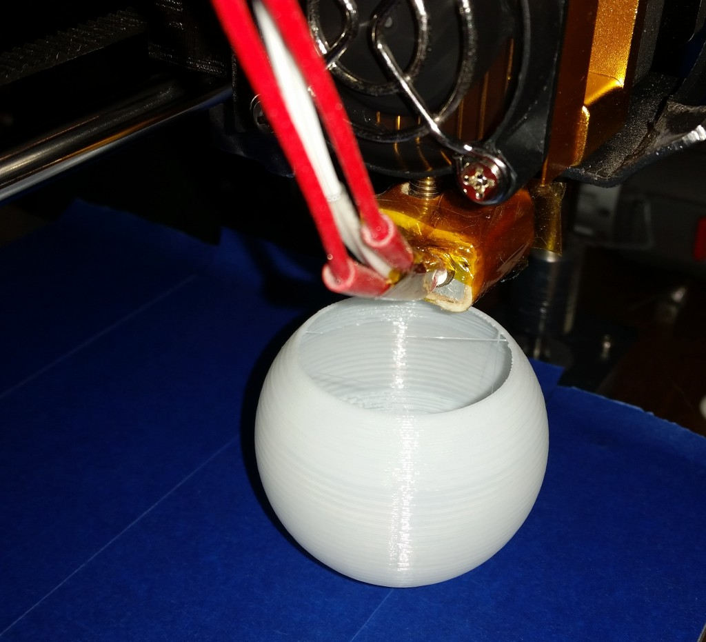 My Hictop Prusa i3 clone 3D printer making a thin sphere.