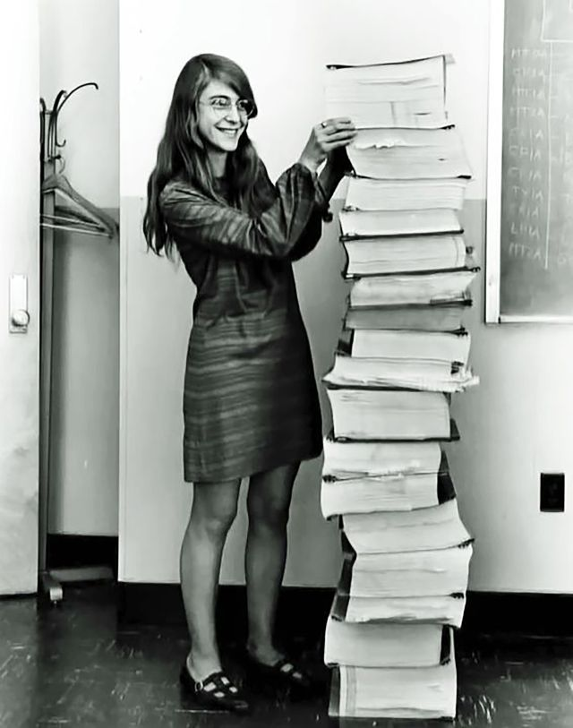Apollo Guidance Computer project lead Margaret Hamilton shows off the printouts of the AGC software.